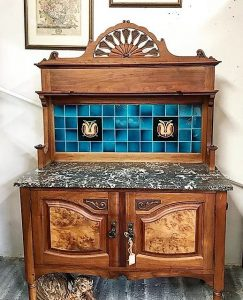 Furniture: Washstand with marble top and blue-tiled back splash