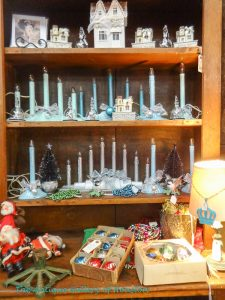 Holiday candles and decor in blue