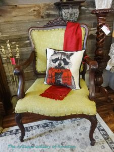 "Armed chair with ""raccoon"" Christmas pillow"