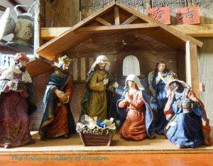 Manger scene with seven painted figurines