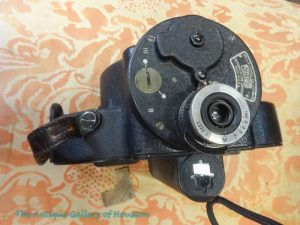 16 mm or 8 mm vintage movie camera with tools and bag, visual media