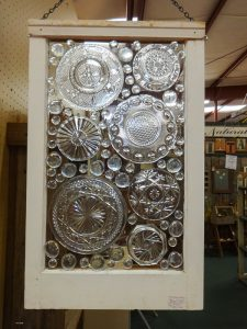 Home decor from recycle glass plates in a vintage window pane