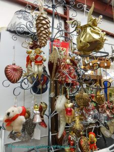 Glass or cloth Christmas tree decoration such as angels, pine cones....
