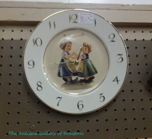 Small wall clock with center Hummel decal of two little girls dancing