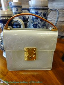 Small gray LV handbag with short strap and large gold clasp