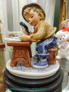Figurine of boy at desk