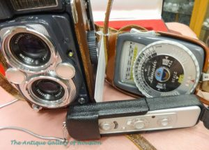 Two cameras and a light meter: Minox camera, Gossen Lumasix light scale and Yashica 44 for the 1950's, visual media