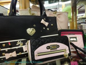 Handbag, organizer, and wallet in black with pink accents