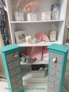 Two six drawer table top towers for odds and ends or jewelry, bookshelf, picture frames for baby's room, Booth J 1