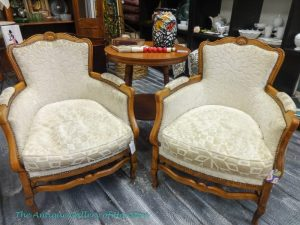 White upholstered side chairs with wood trim