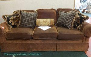 Soft, dark brown sofa, three cushions and extra pillows
