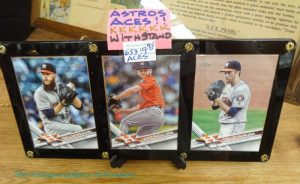 Trio frame with stand containing baseball cards of Astros pitchers (2017)