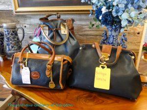 3 Navy blue or black handbags, showcases 25-27