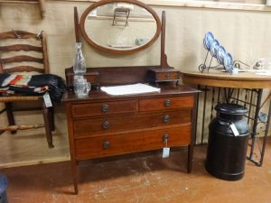 Furniture and decor: Vanity with oval mirror and milk can, dealer E5
