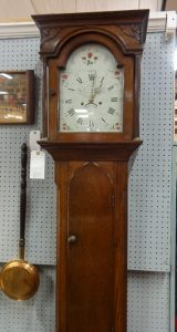 Grandfather clock with vintage stenciling on clock face
