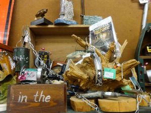 Display of fishing lures and reels found in booth F10