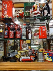 Coca-cola collectibles from bottles to radios, dealer 729, E16