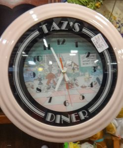 "Cartoon inspired clock, pink with words ""Taz's Diner"""