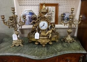 Antique clock with cherubs on each side