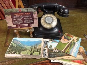 Display of postcards next to vintage desk phone, G1, 713
