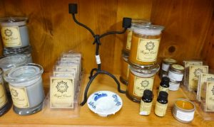 Candles in jars, wax for burners, and bottled scents