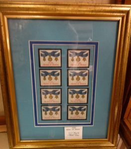 Framed display of eight stamps honoring Medal of Honor winners, Dealer 3034, showcase 3