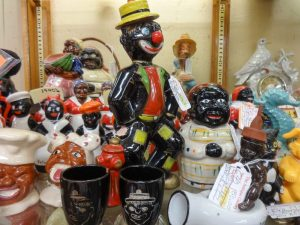 Wide range of porcelain collectibles known as Black Americana portraying stereotyped characters; Dealer 642, showcase 1