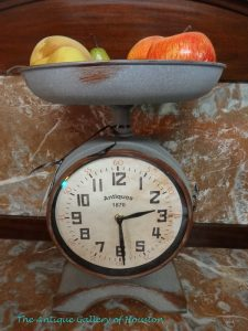 Rustic looking clock with tray on top like an old scale