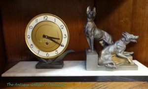 Mid-century style clock, metal and marble base with sculpture of two shepherd dogs on the right.