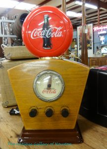 Mid-century style wooden base for radio with round coca-cola symbol on top