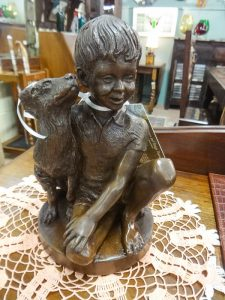 """Small 9 """" sculpture of boy with dog by Charles Park for the Franklin Mint, 1974, Booth B4"""
