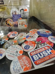 Selection of political campaign buttons from Reagan to the Bushes, Booth A8