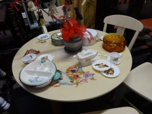 Round table and four chairs for child with children's play dishes, Booth B5b