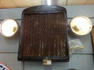 Vintage radiator/grill with lights from tractor, Booth 461
