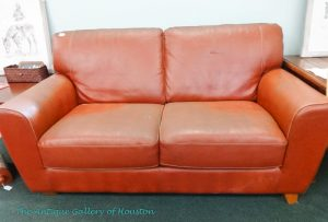 Caramel colored leather loveseat