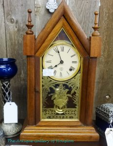 "Mantel or table-top cathedral-style chiming clock, 20"" tall with 12"" wide base, etched glass door"