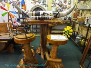 Table and two stools from roughly cut wood, cattle horns, Booth J 11