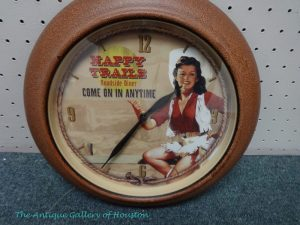 Round clock with picture of cowgirl, Booth F13