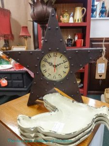 Wall clock in star-shaped frame