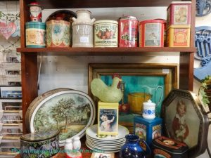 Various shapes and sizes of decorative tin boxes and cannisters, Booth P 1