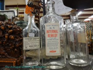 Assortment of vintage glass medicine bottles, Booth Q4