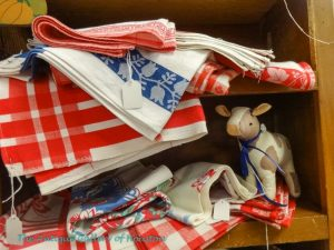 Red and white checkered, blue patterned farmhouse inspired kitchen linens,