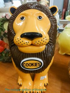 """Cookie jar says """"Get your hand outta my cookie jar"""" when lid is raised."""