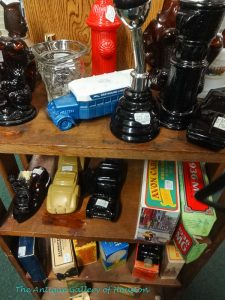 Selection of Avon bottles such as cars, some in boxes, Booth W 5, 6