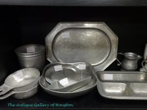 Selection of various pewter serving pieces,