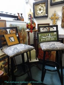 Black metal bar stools with zebra fabric upholstery, Booth L8