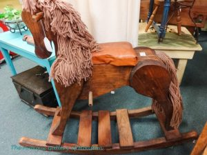 Large wooden rocking horse with yarn mane and tale, Booth X6