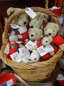 Large basket with about eight various size bears dressed mostly in red, Booth U7/T7