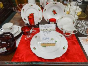 White china with red roses, red glassware