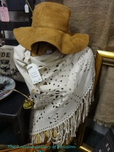 Western style suede fringed shawl and floppy brimmed suede hat